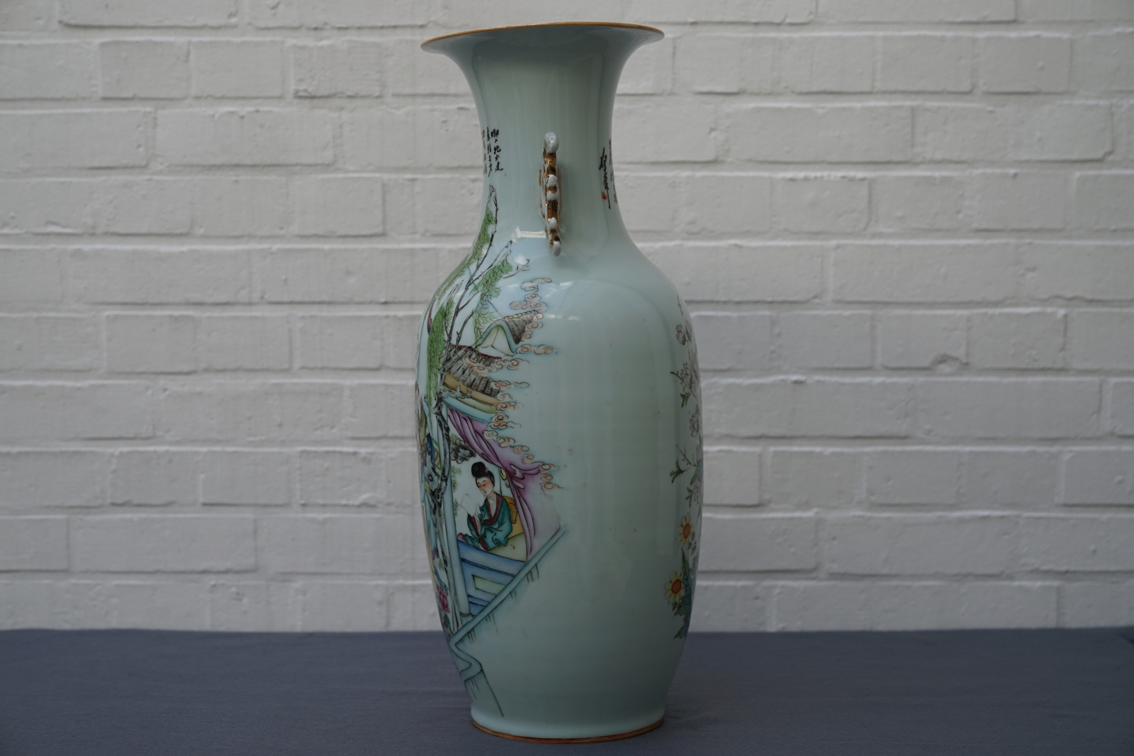 Lot 57 - A Chinese famille rose two-sided design vase, 19/20th C.