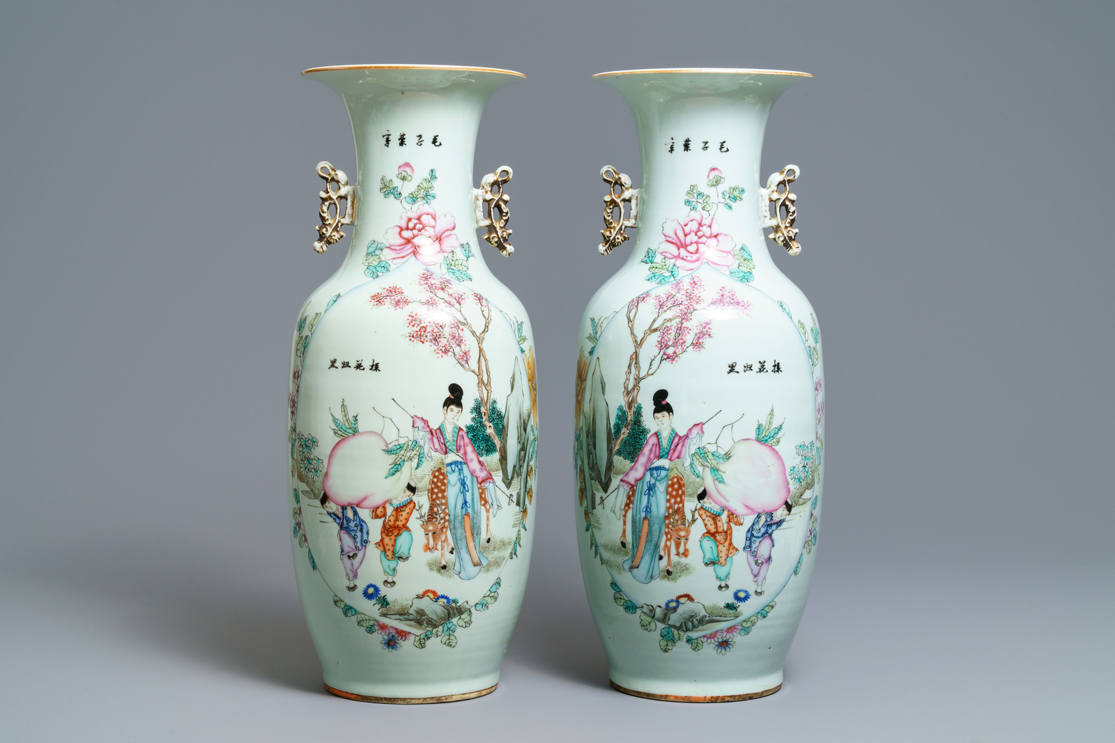 Lot 44 - A pair of Chinese famille rose 'Magu' vases, 19/20th C.