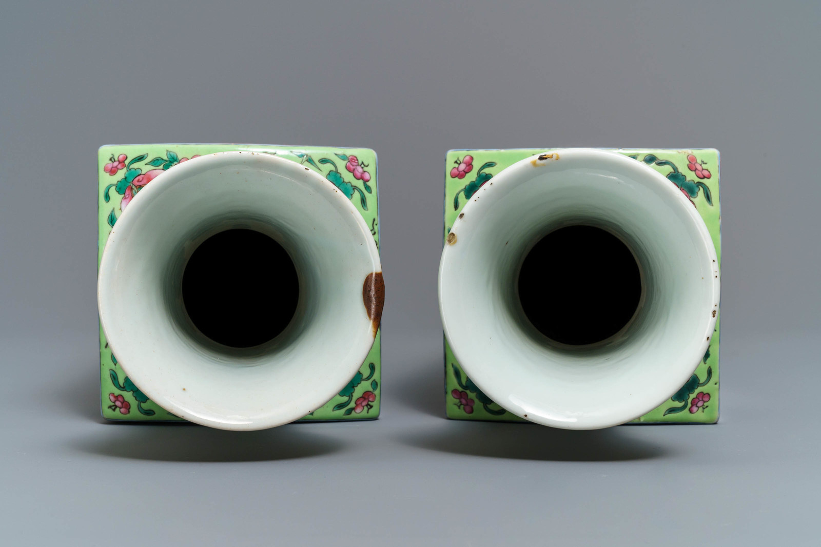 Lot 36 - A pair of square Chinese famille rose 'mythical beasts' vases, 19/20th C.