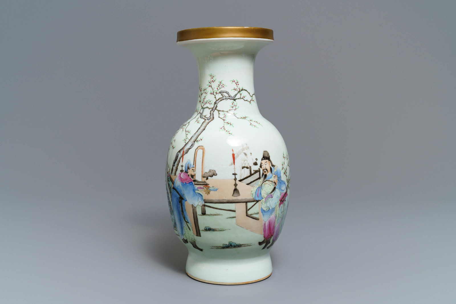 Lot 7 - A Chinese famille rose vase with figures in a garden, Qianlong mark, Republic, 20th C.
