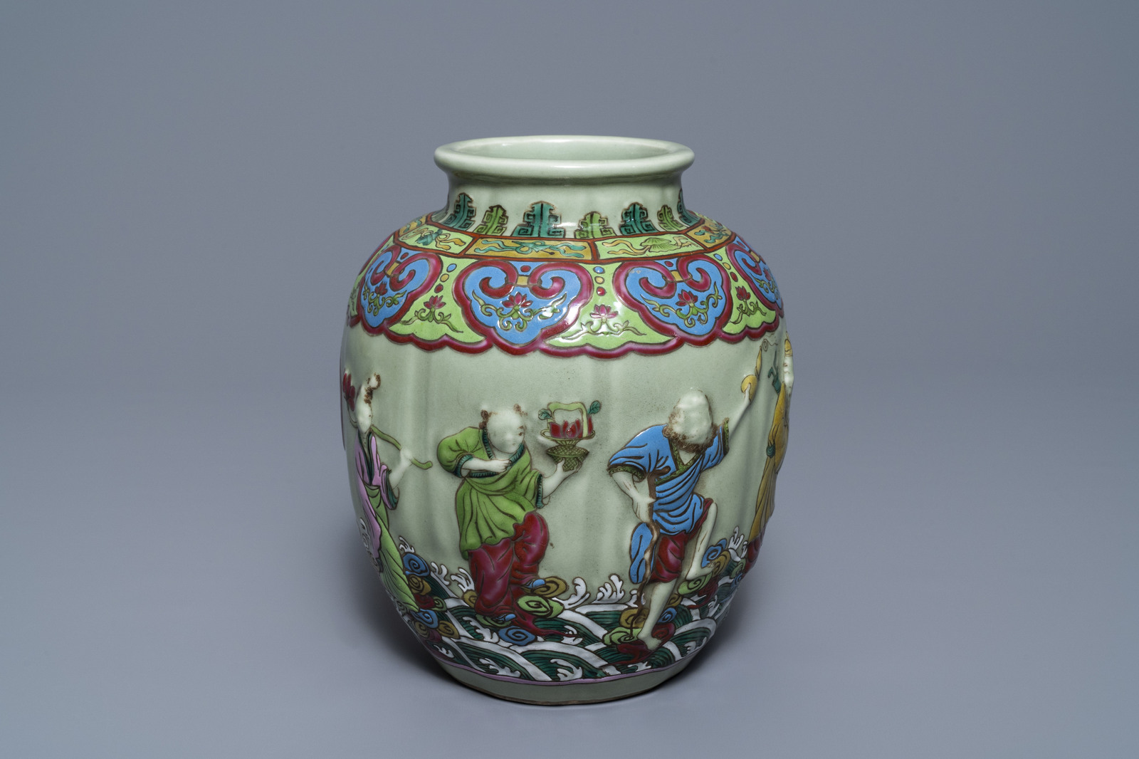 Lot 25 - A Chinese relief-decorated famille rose celadon-ground vase, 19/20th C.