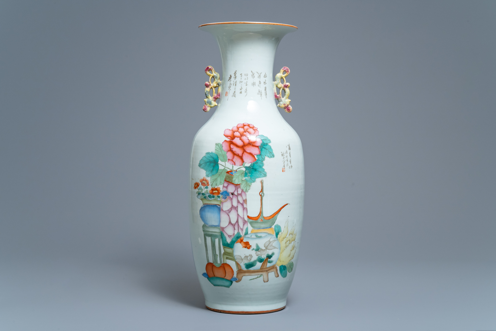 Lot 32 - A Chinese famille rose two-sided design vase, 19/20th C.