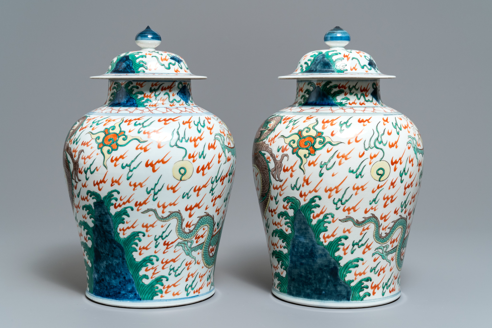 Lot 49 - A pair of wucai-style vases and covers with dragons, Samson, Paris, 19th C