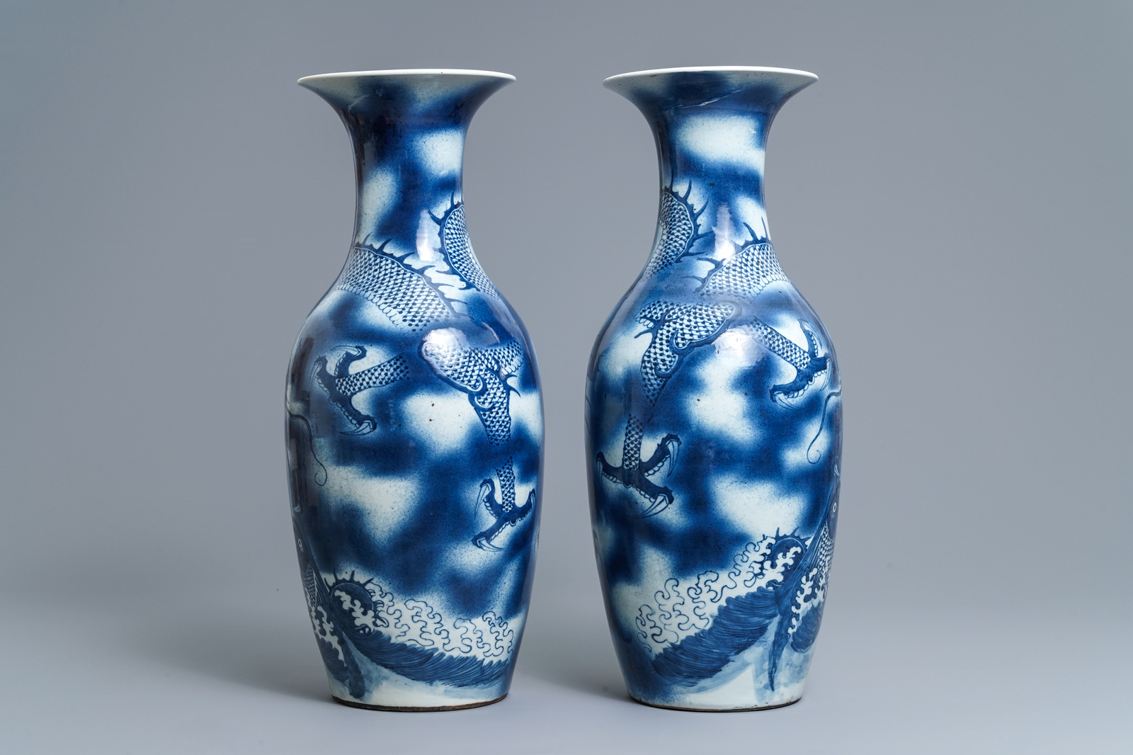 Lot 62 - A pair of Chinese blue and white 'dragon and carp' vases, 19th C.