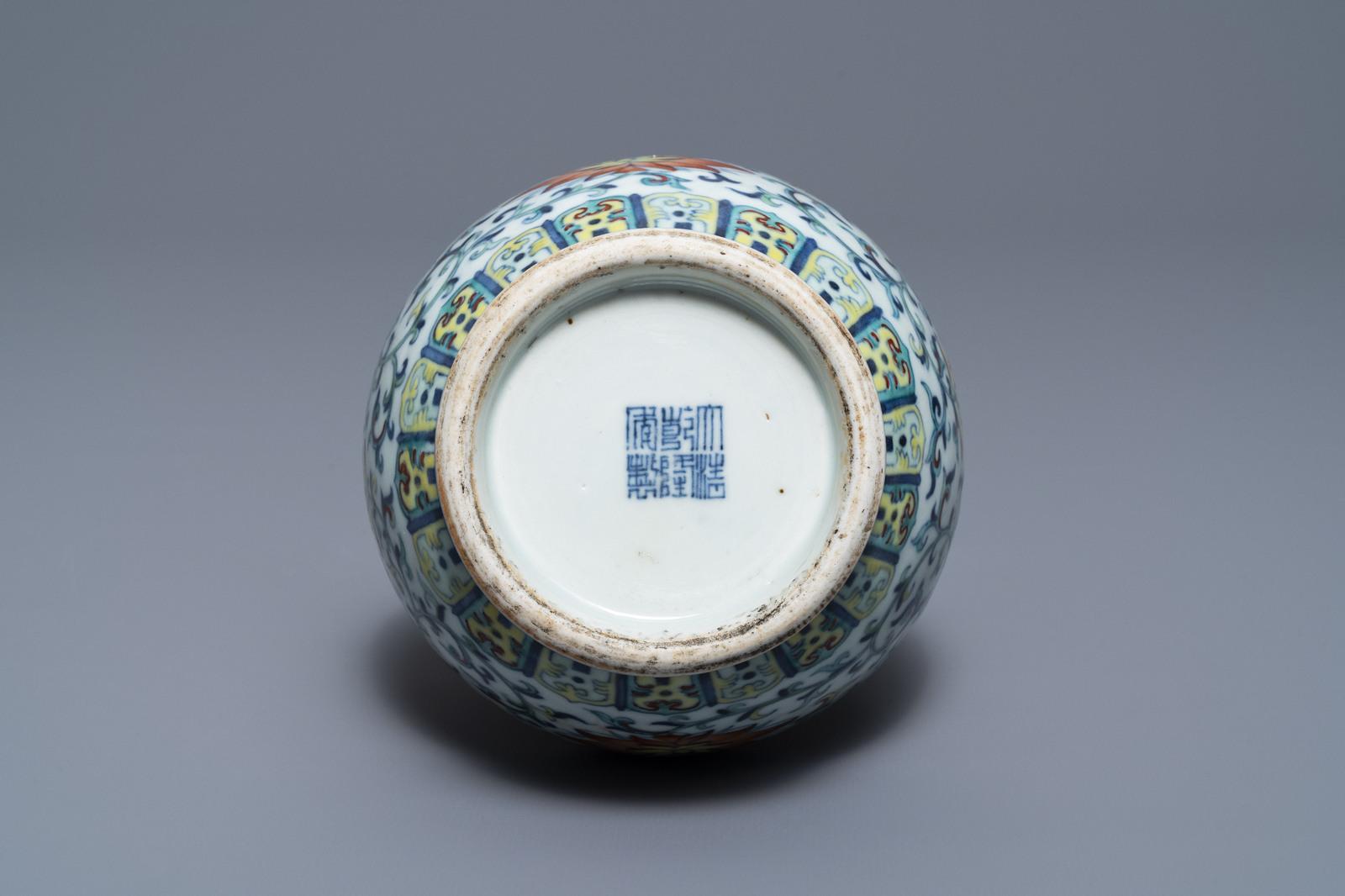 Lot 30 - A Chinese doucai 'hu' vase, Qianlong mark, 19/20th C.