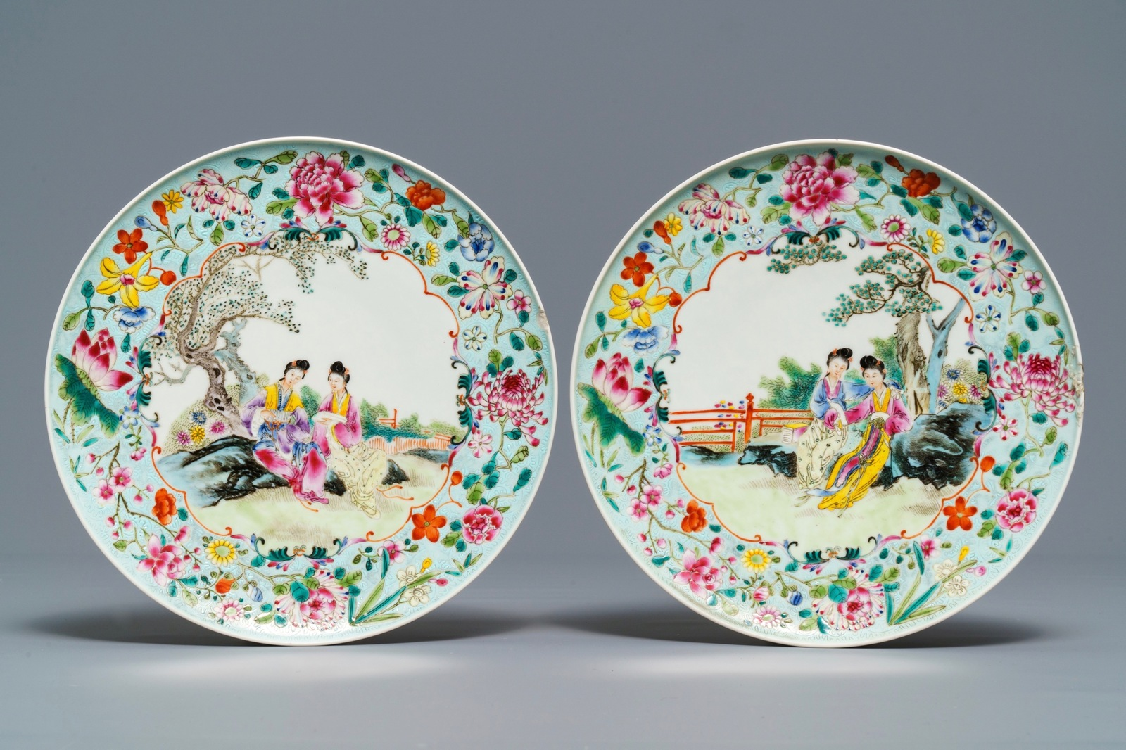 Lot 6 - Four Chinese famille rose plates with ladies in a garden, Guangxu mark, Republic, 20th C.