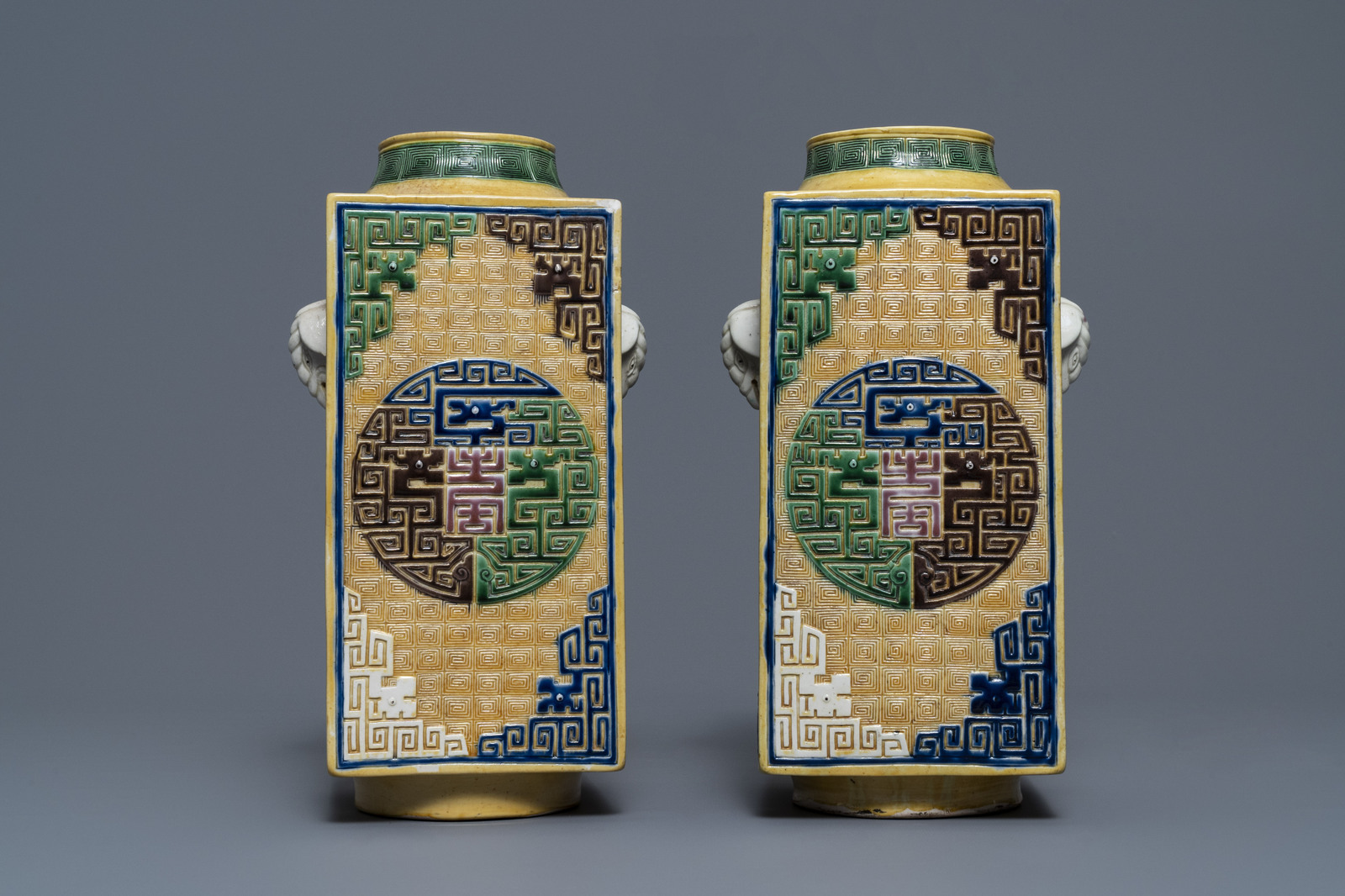 Lot 26 - A Chinese celadon jardinire and a pair of relief-decorated cong vases, 19/20th C.