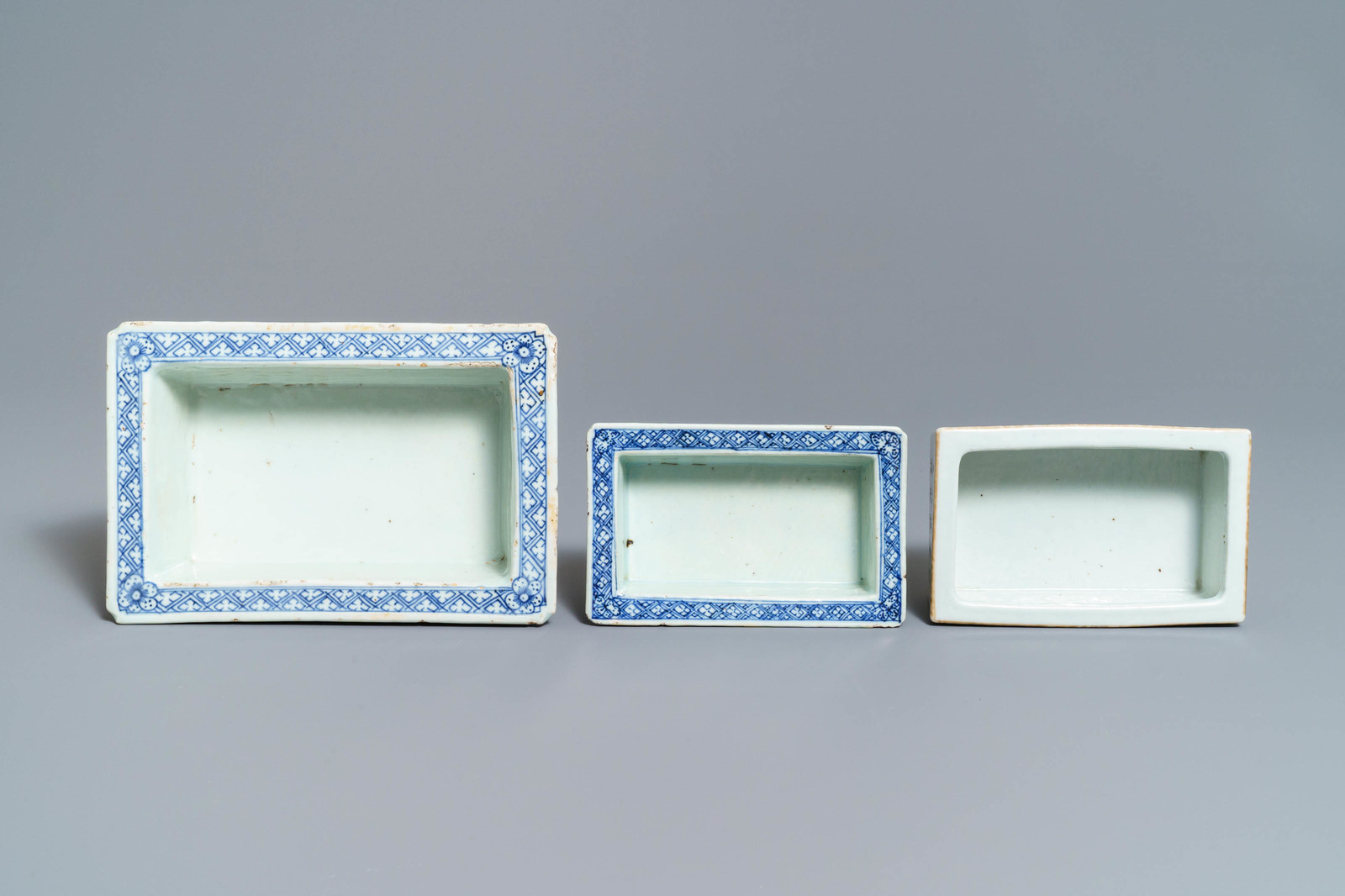 Lot 45 - Five pieces of Chinese iron red porcelain and two double-walled blue and white jardinières, 19th C.