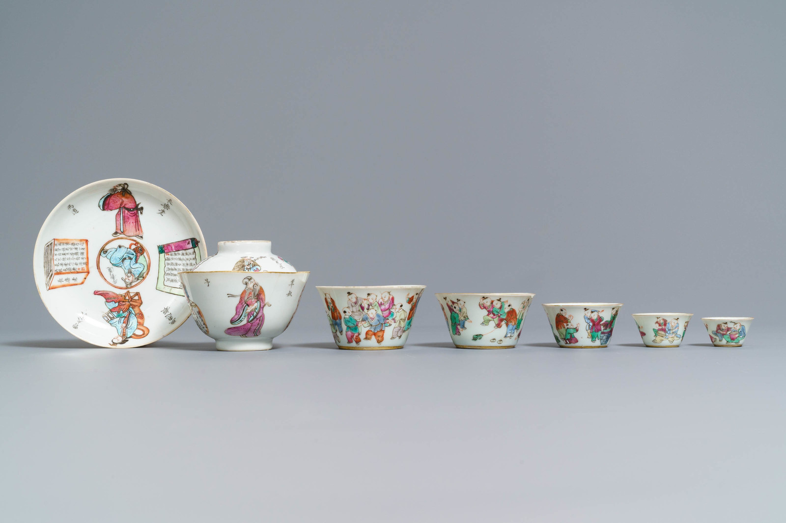 Lot 42 - Five Chinese famille rose nesting cups and a Wu Shuang Pu cup and saucer, 19th C.