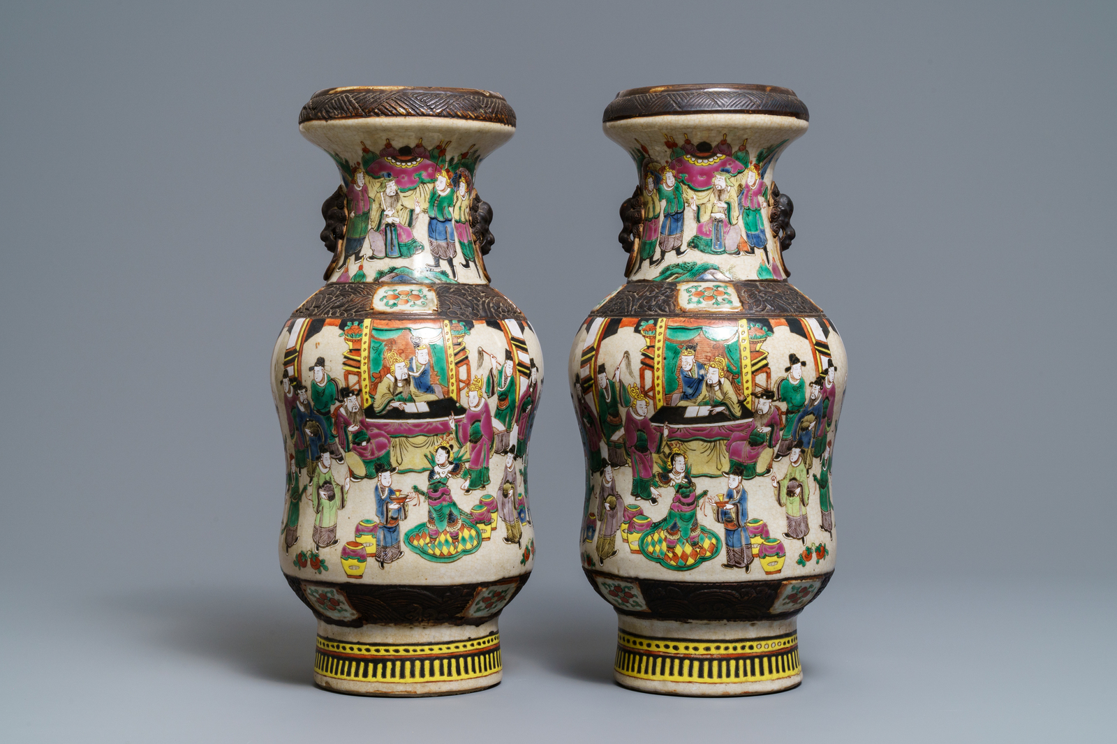 Lot 61 - A pair of Chinese Nanking famille rose vases, 19th C.