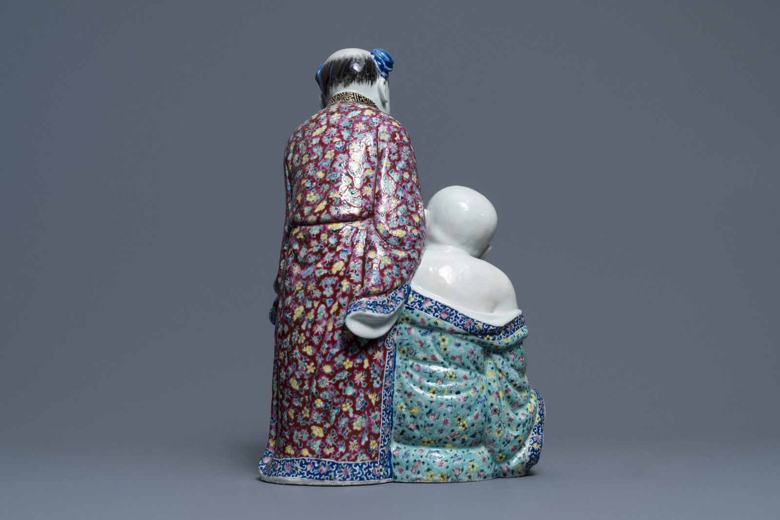 Lot 4 - A Chinese famille rose group of two children, impressed marks, Republic, 20th C.
