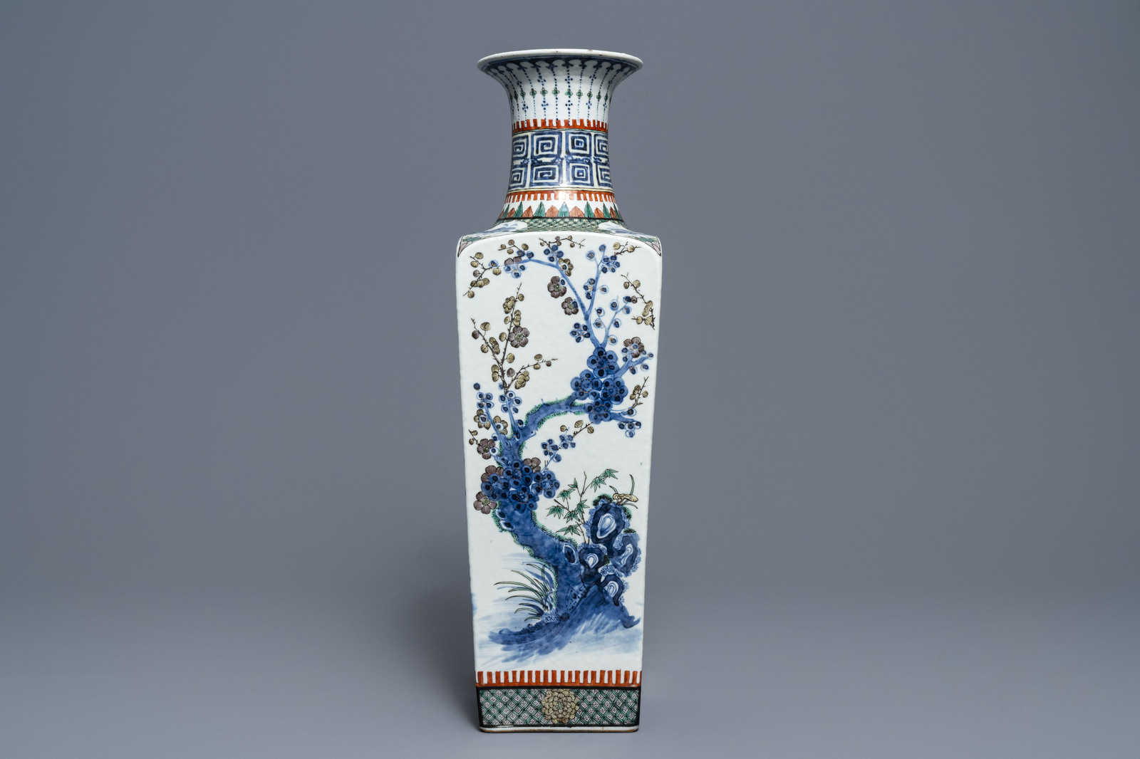 Lot 46 - A square Chinese famille verte vase with floral design, 19th C.