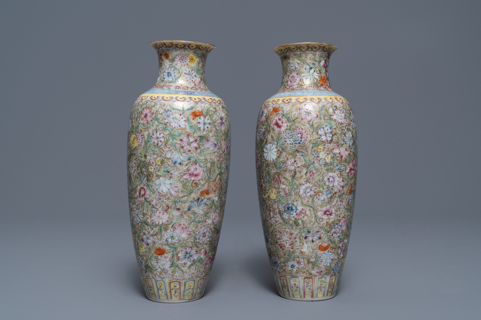 Lot 3 - A pair of Chinese famille rose 'millefleurs' eggshell vases, Qianlong mark, Republic, 20th C.