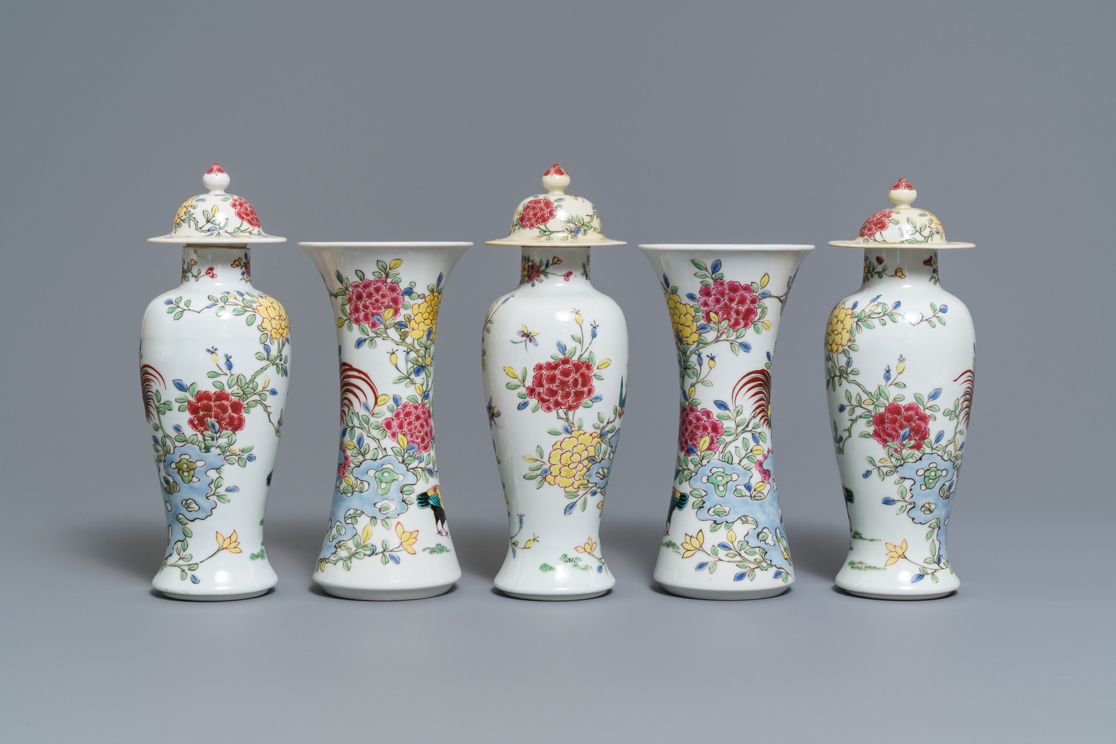 Lot 50 - A famille rose-style five-piece garniture with roosters and chickens, Samson, Paris, 19th C.