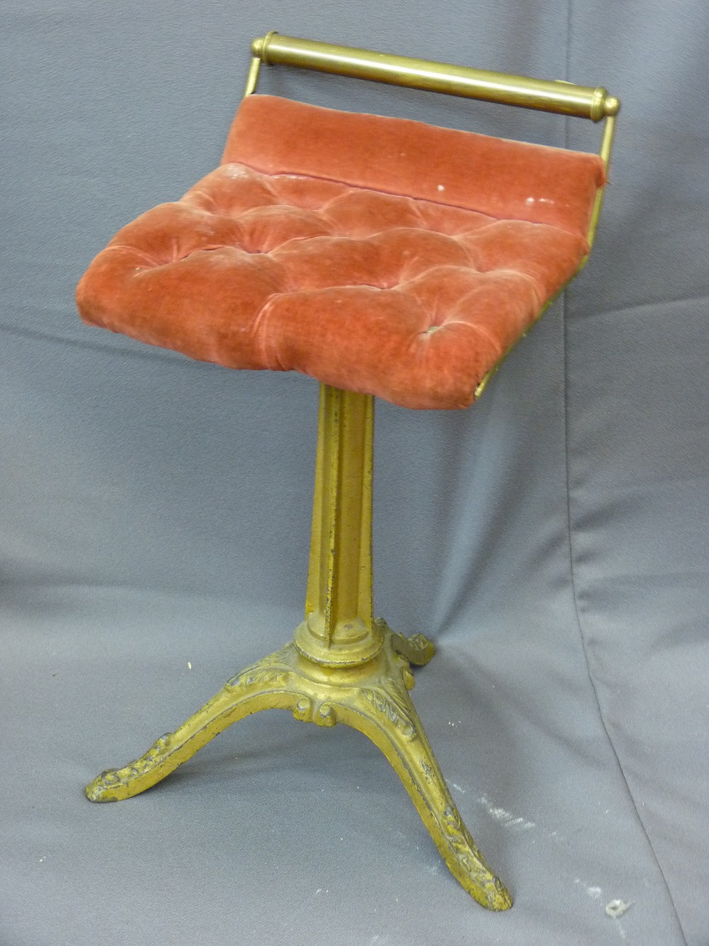 Lot 57 - METAL FRAMED RISE & FALL SEAT on tripod base with red buttoned upholstery