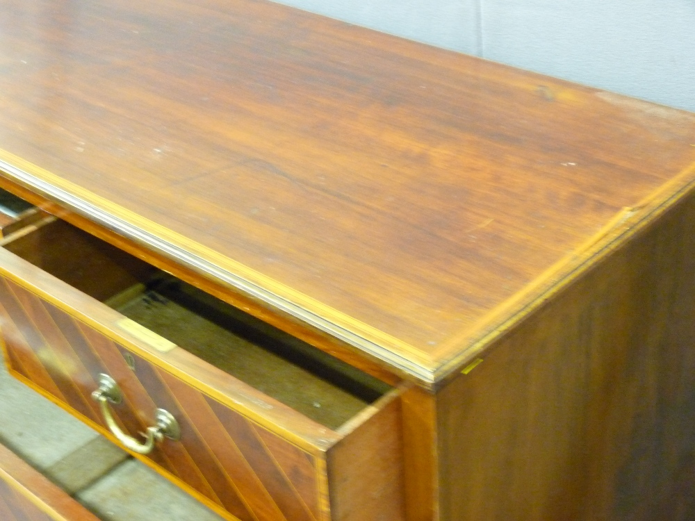 Lot 28 - MAHOGANY CROSS BANDED TWO OVER THREE GRADUATED CHEST OF DRAWERS by makers 'Maple and Co', 106cms