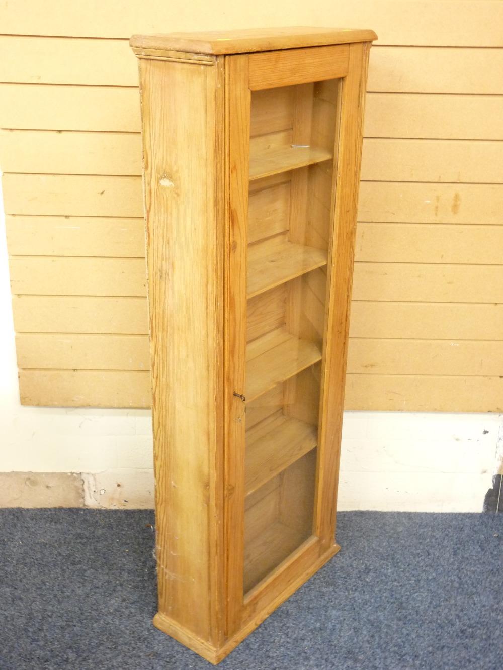 Lot 51 - SLIM PINE DISPLAY/BOOK-CASE CABINET, 129cms height, 51cms width, 20cms depth