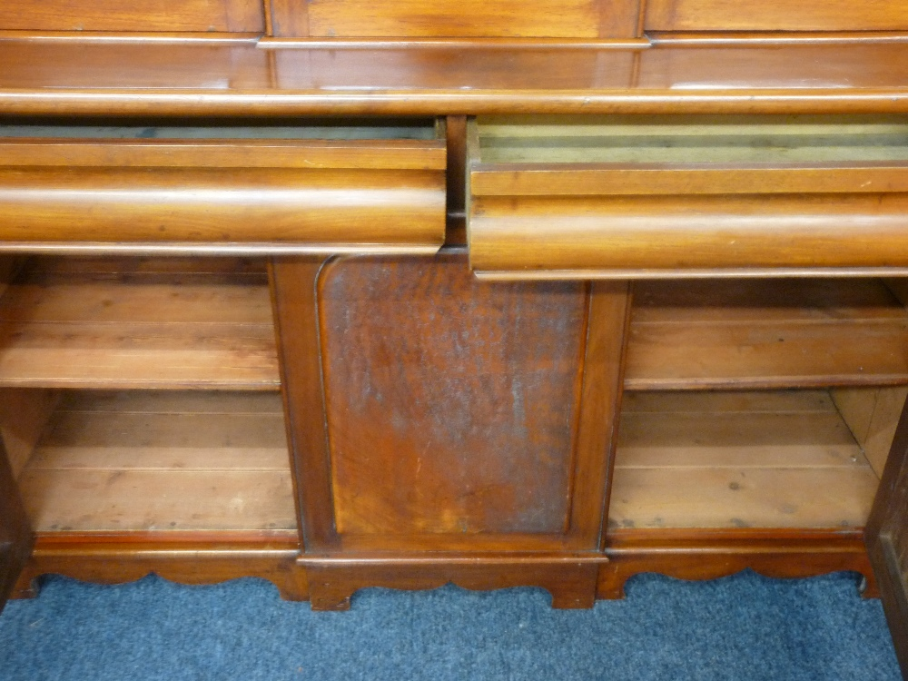 Lot 32 - MAHOGANY CWPWRDD GWYDIR with three glazed panels over two base drawers and two flanking base