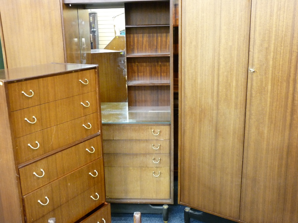 Lot 33 - G PLAN GOLD LABEL BEDROOM SUITE comprising double wardrobe, seven drawer chest and a compactum
