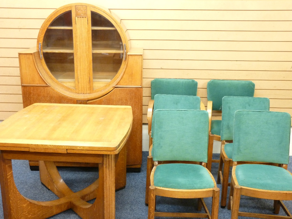 Lot 25 - ART DECO DINING SUITE comprising sideboard with circular glazed doors, draw leaf table and set of