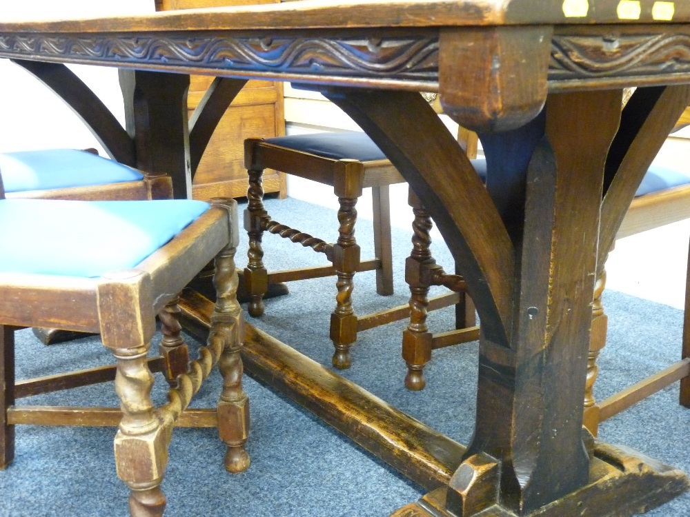 Lot 42 - FINE ANTIQUE FOUR PLANK REFECTORY TABLE with carved edge details and four cane back twist support