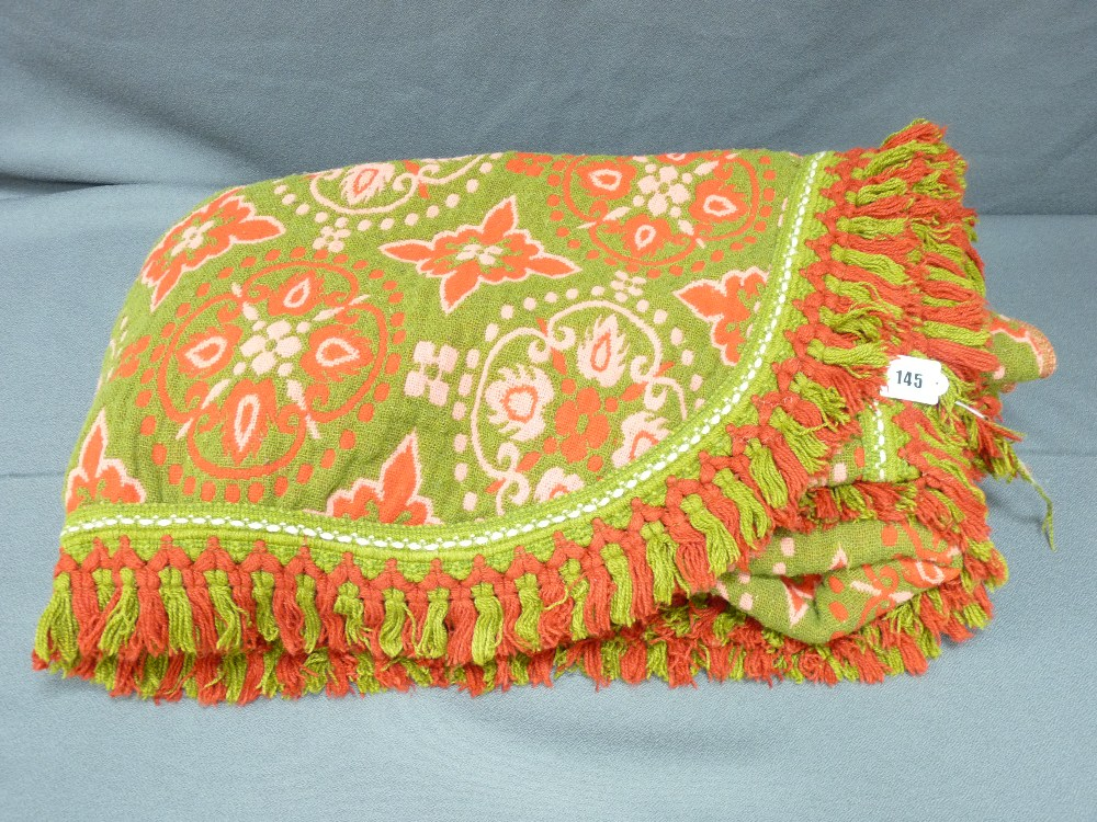 Lot 145 - POSSIBLY WELSH WOVEN WOOL BEDSPREAD in green, pink and red reverse patterning, 240 x 200cms
