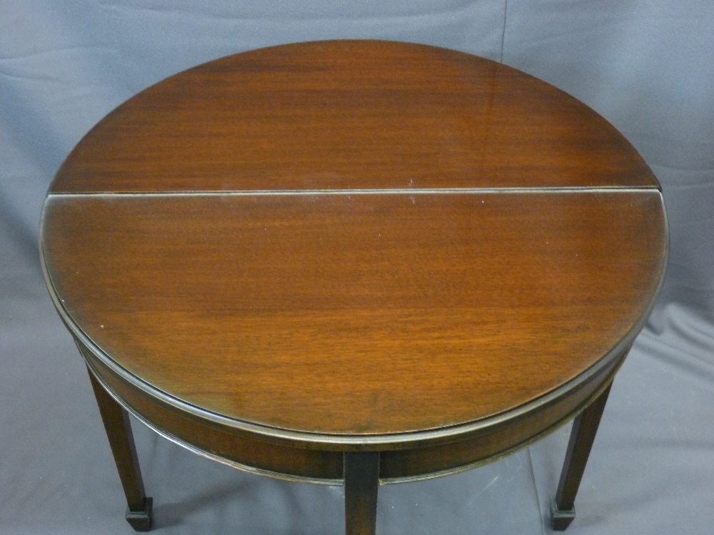 Lot 23 - MAHOGANY FOLD-OVER TEA TABLE with rope edging, tapered supports and spade fee, 76cms height, 80cms