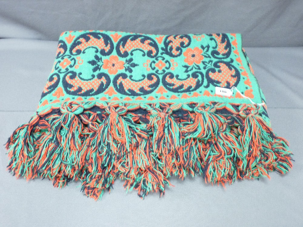 Lot 146 - POSSIBLY WELSH WOVEN WOOL BEDSPREAD, green, red and black reverse tones with tasselled ends, 220 x