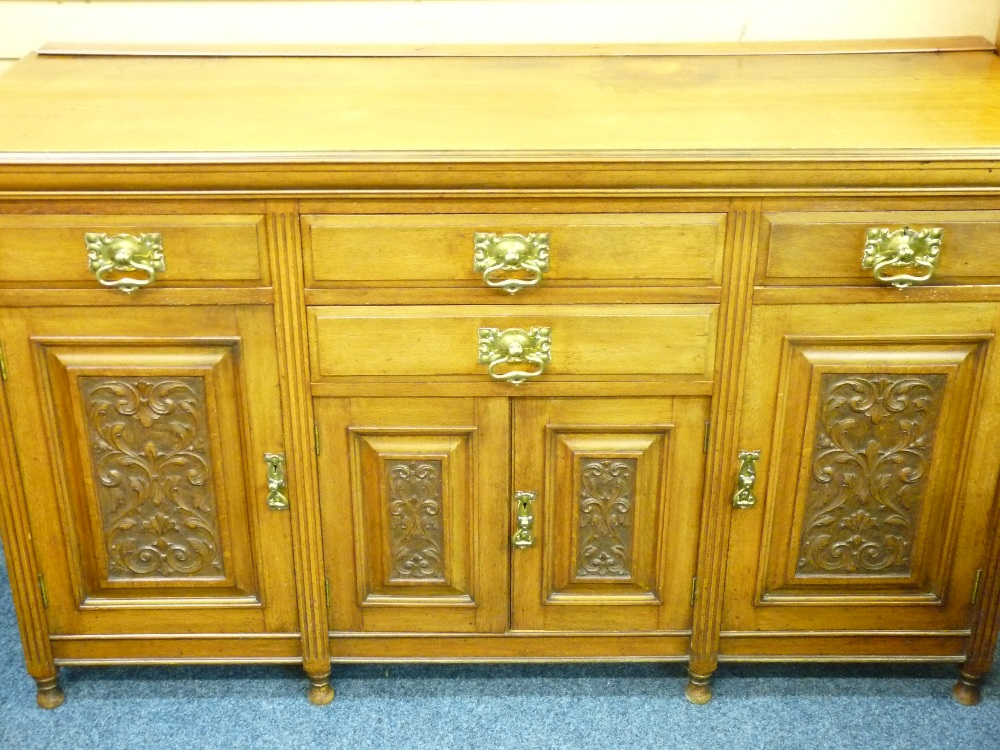 Lot 29 - VICTORIAN OAK SIDEBOARD with carved panel front doors, 99cms height, 168cms width, 58cms depth