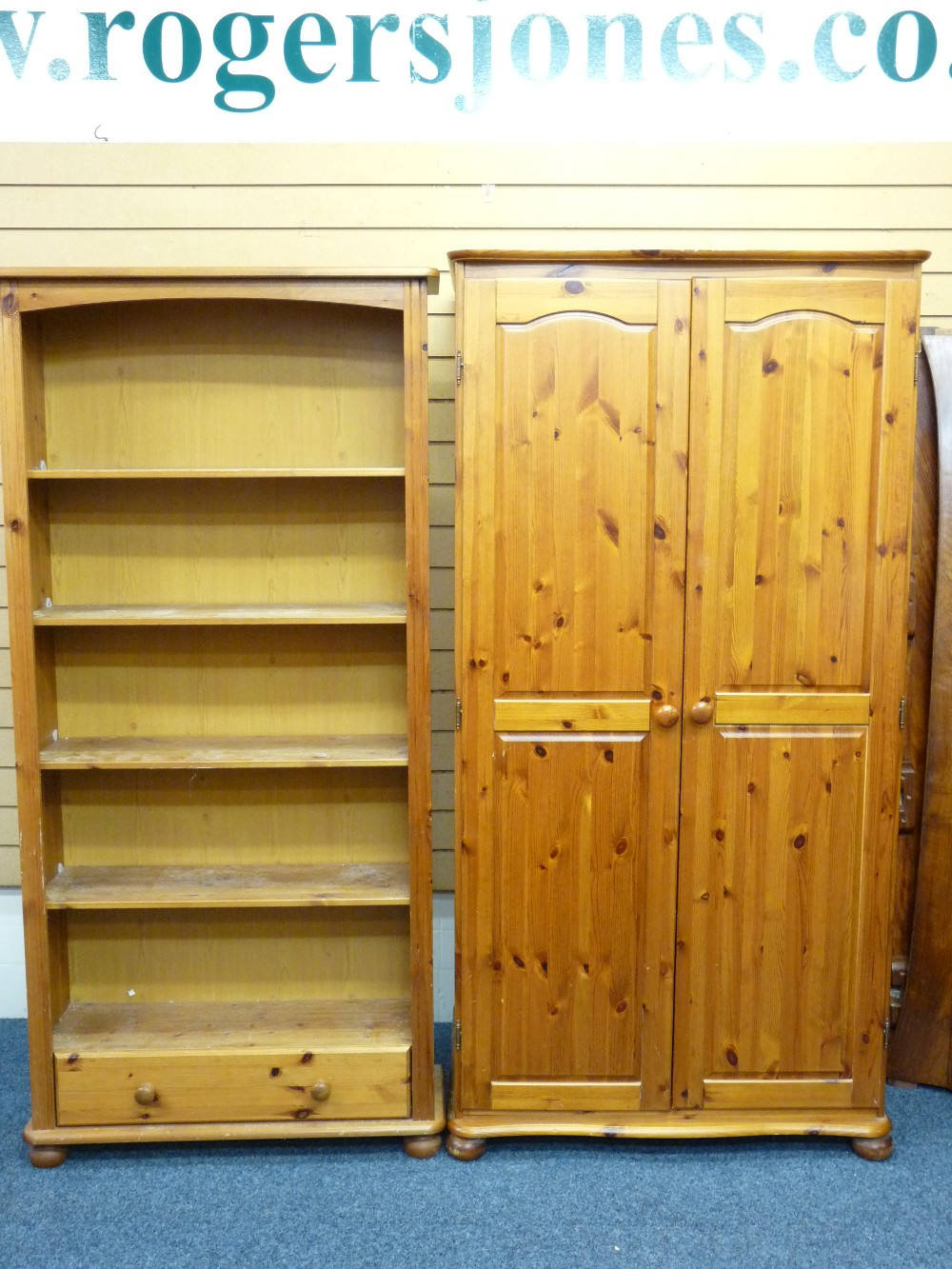 Lot 49 - MODERN PINE FURNITURE - a two door wardrobe and an open shelf bookcase with base drawer