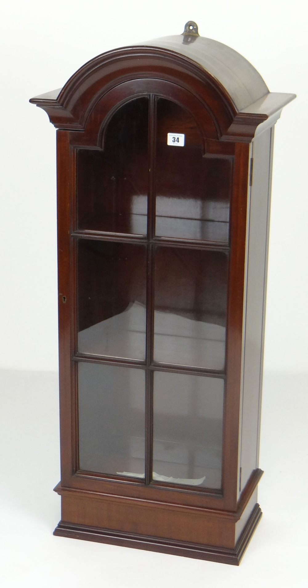 Lot 34 - NEAT ANTIQUE-REPRODUCTION HANGING MAHOGANY CABINET, single sectional glazed door with dome top,