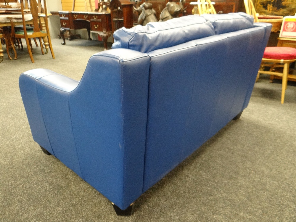 Lot 44 - RETRO STYLE BLUE LEATHER TWO SEATER SETTEE