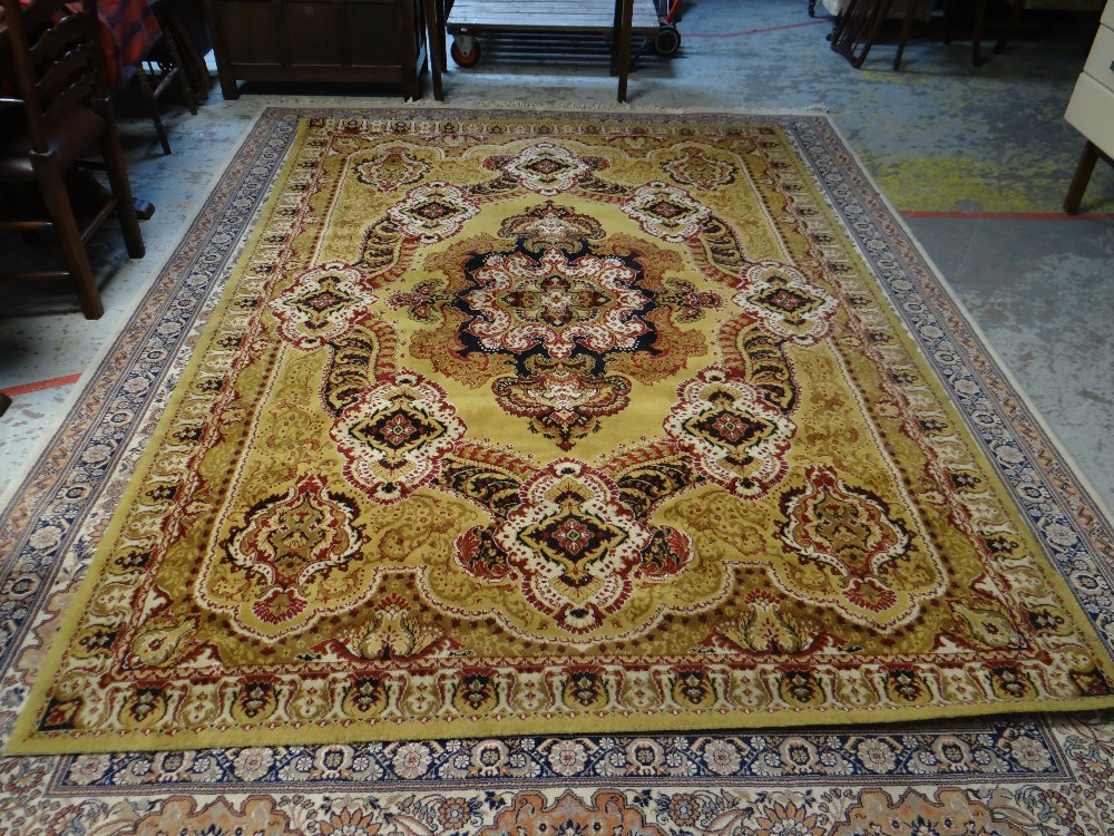 Lot 52 - LARGE MAINLY FAWN & BLUE MULTI-PATTERNED PERSIAN RUG with large centre cartouche decoration and