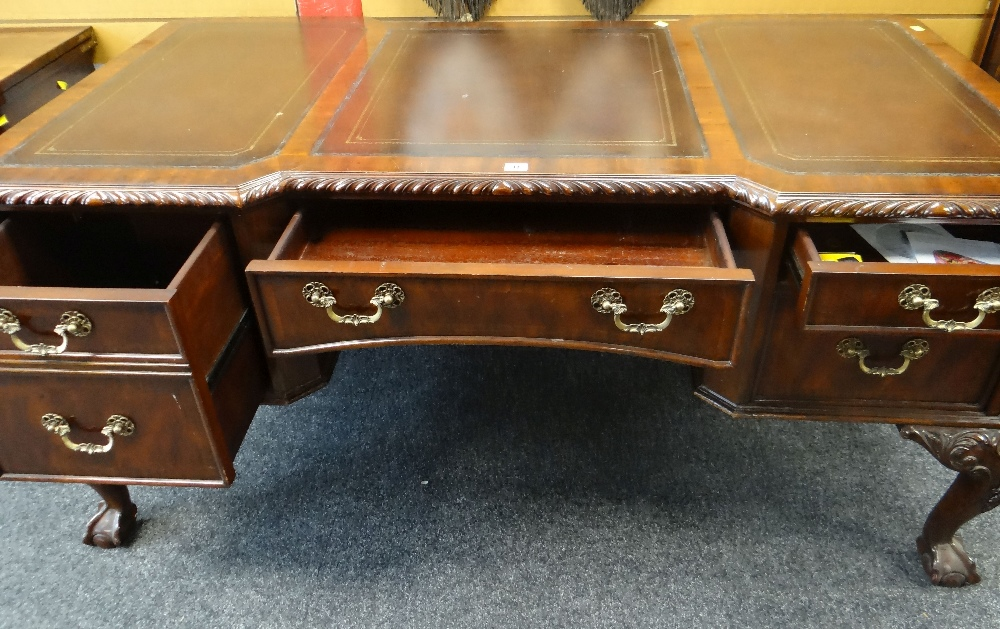 Lot 17 - REPRODUCTION BREAK-FRONT DESK on ornate carved ball and claw supports and with bank of five drawers,