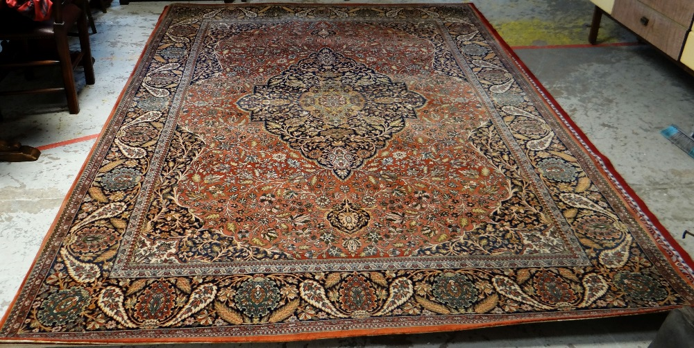 Lot 51 - LARGE MAINLY RED & BLUE GROUND PERSIAN WOOLEN RUG with floral centre decoration and border, 325 x
