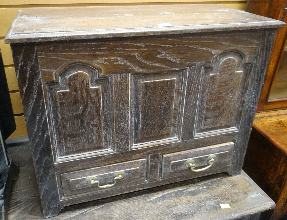 Lot 7 - GOOD 20TH CENTURY OAK COFFER BACH carved with three panels and with two lower drawers, 68cms wide