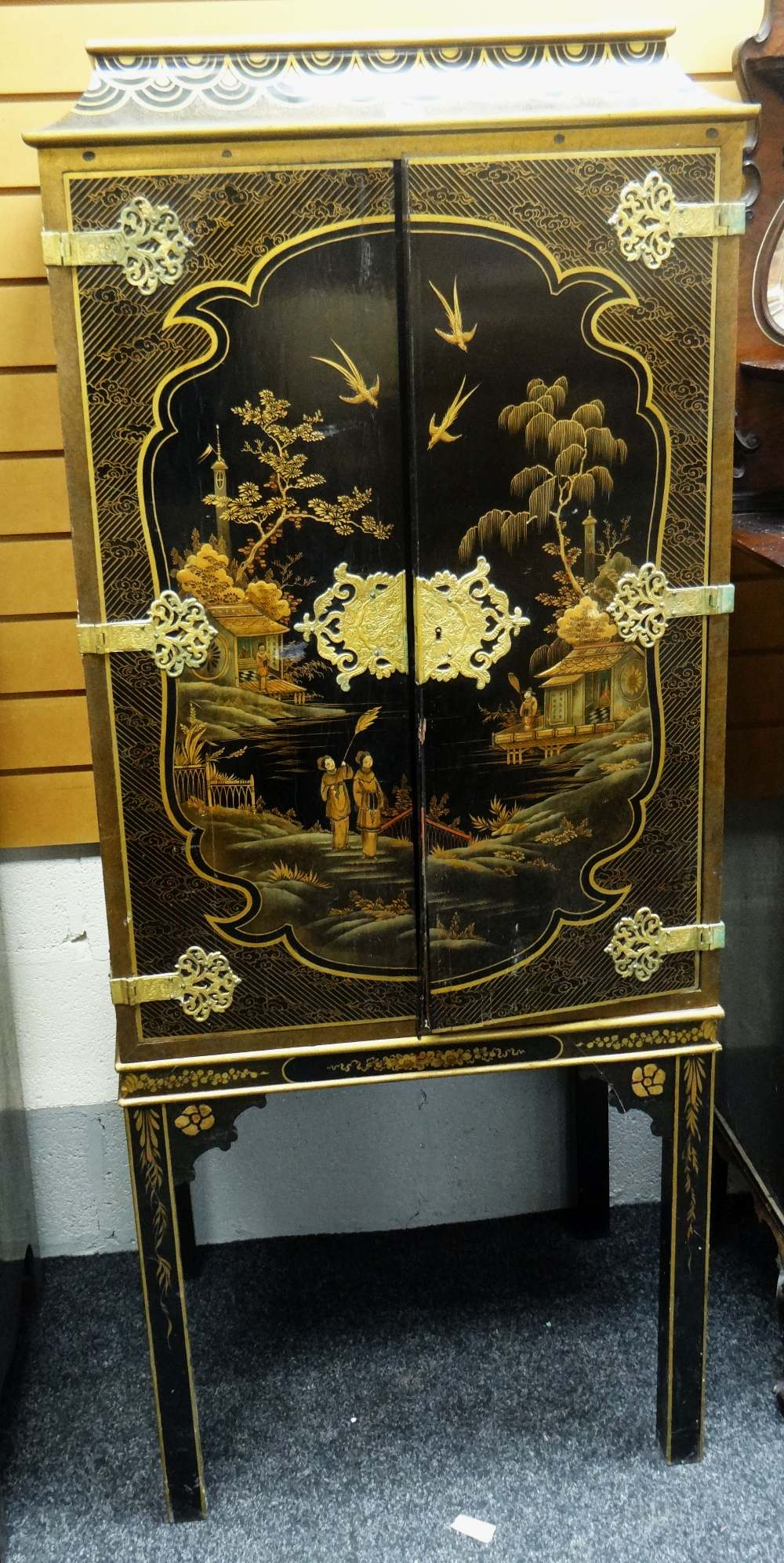 Lot 13 - 20TH CENTURY JAPANNED CABINET, two doors centred with large village scene with figures, decorative
