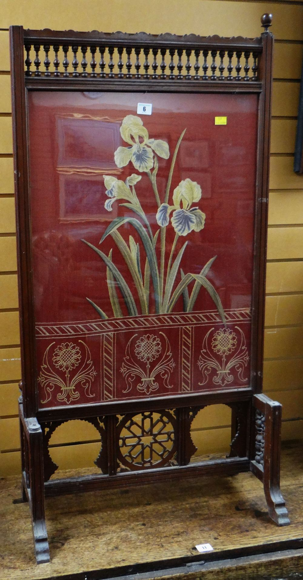Lot 6 - AESTHETIC-MOVEMENT FIRE SCREEN with carved bobbins and open work, the panel with floral upholstery