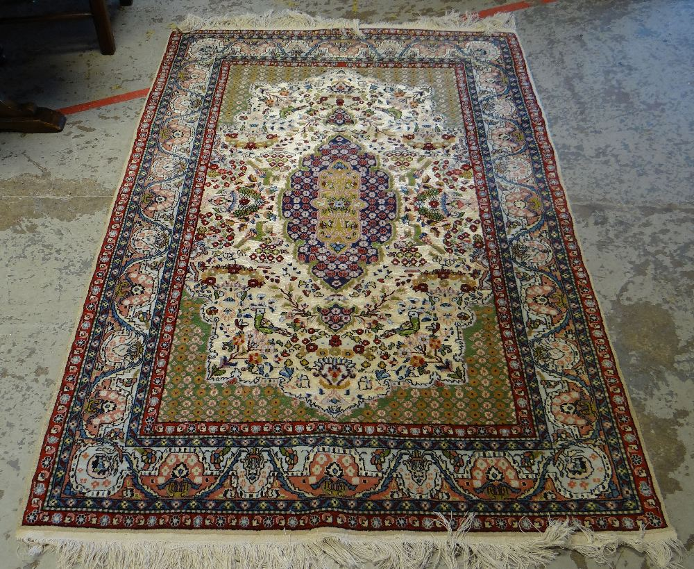 Lot 49 - GOOD FINE WOOL PERSIAN RUG with bird and flower centre decoration and red and blue ground border,