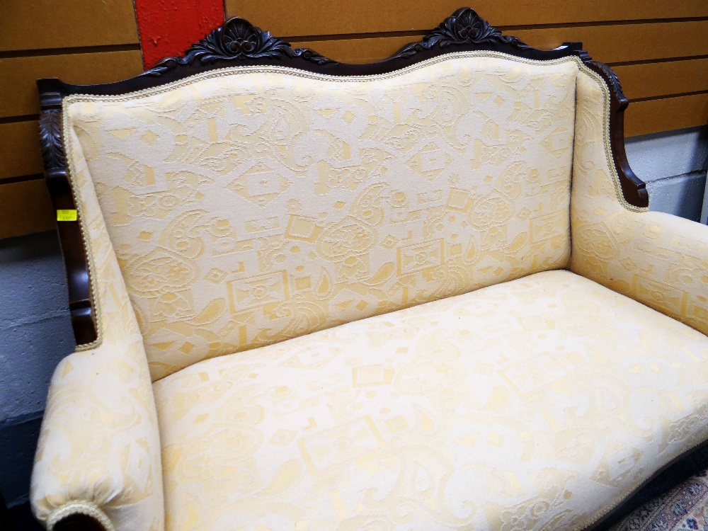 Lot 16 - CARVED FRAME ANTIQUE TWO SEATER SETTEE, yellow arabesque upholstery, 116cms wide
