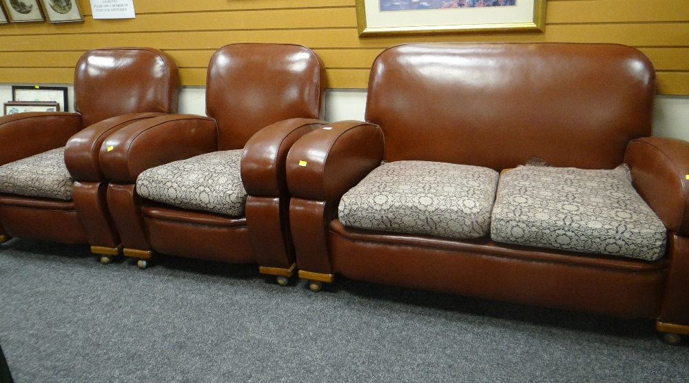 Lot 27 - CIRCA 1940's / 50's ART DECO INFLUENCE LEATHERETTE THREE PIECE SUITE comprising two seater settee