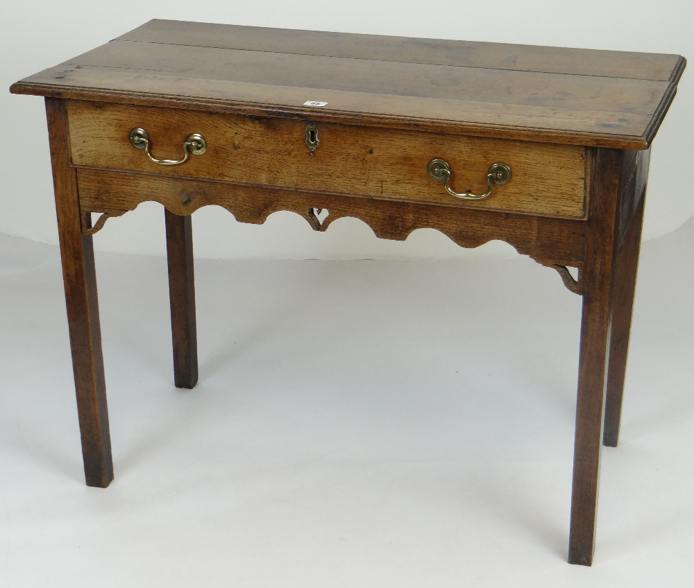 Lot 35 - ANTIQUE OAK SIDE TABLE with single drawer, brass handles, carved arches to frieze, 95cms wide