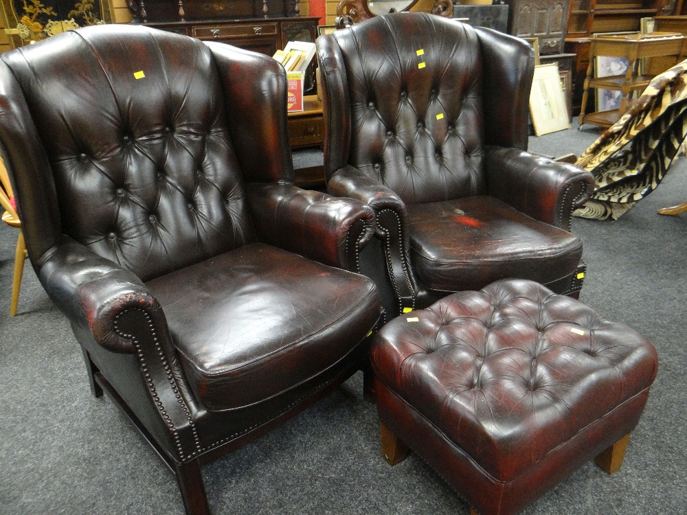 Lot 22 - PAIR OF STUDDED RED LEATHER CLUB STYLE ARM CHAIRS & MATCHING FOOT STOOL