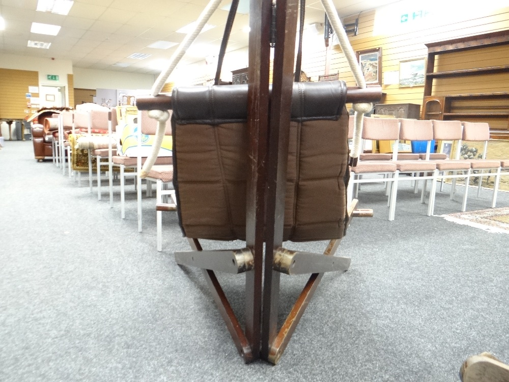 Lot 32 - PAIR OF JATOBAH WOOD DOMINIC MICHAELIS 'SAIL' LOUNGE CHAIRS in chocolate cow-hide leather, foam