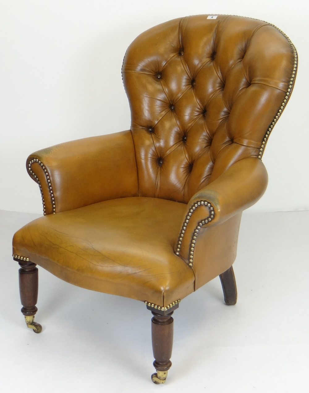Lot 4 - BUTTONED & STUDDED TAN LEATHER SPOON BACK ARMCHAIR