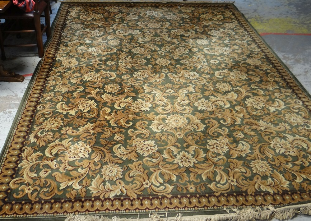 Lot 55 - MAINLY BROWN & BLUE GROUND WOOLEN SAMARKAND RUG with pattern border and mirrored flower decoration