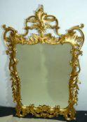Großer Prunkspiegel. Reich verzierter Goldrahmen. Maße ca. 74x128 cm.Large splendour mirror. Rich