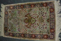 Orientteppich mit Seidenanteil. Vintage. Maß ca. 78x118 cm.Oriental carpet. Vintage. Meassure