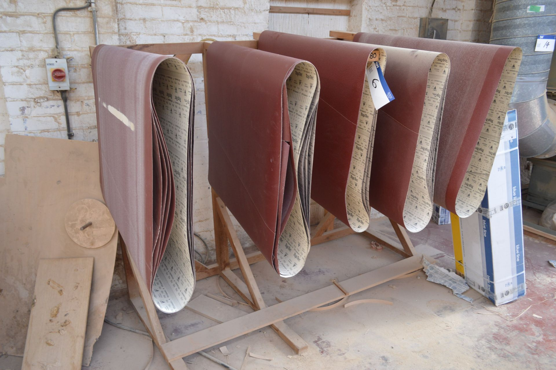 Lot 6 - Assorted 1100mm wide Sanding Belts, with timber rack and in box
