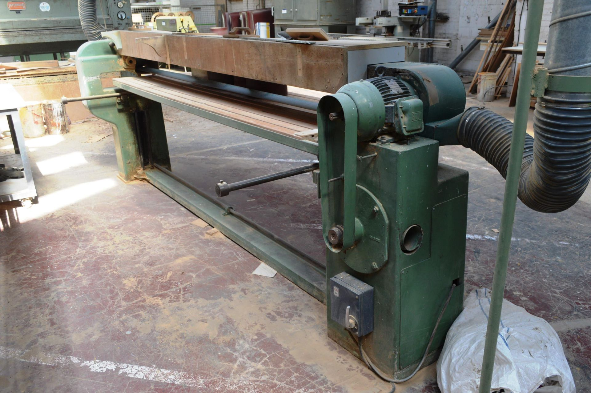 Lot 20 - Dominion DDA OVERHEAD PAD SANDER, serial no. 169, with flexible and spiral wound ducting to and